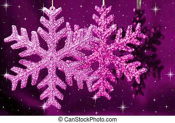 Christmas snowflakes on purple background