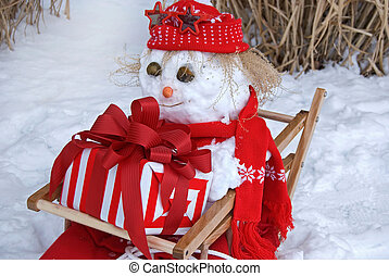 Christmas snowman in sled