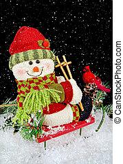 Christmas snowman on sled