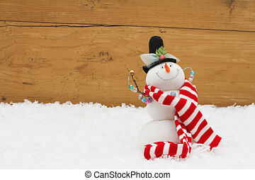 Happy Holidays, A Snowman on snow with a weathered wood background and copy-space for your message