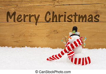 Merry Christmas Message, A Snowman on snow with a weathered wood background and text Merry Christmas