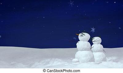 Christmas snowmen at night