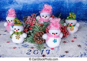 Christmas snowmen, decoration, beautiful toys and the inscription 2017.