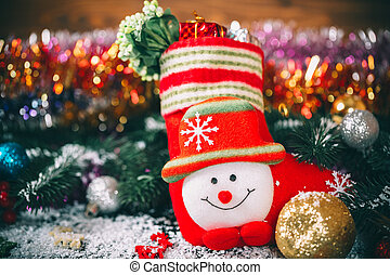Christmas sock with decor and gifts on a wooden background