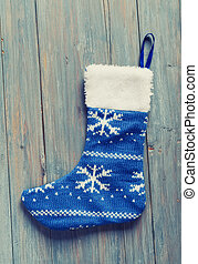 Christmas sock with on wooden background