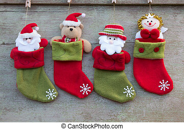Christmas socks and Christmas decoration on white wooden background,