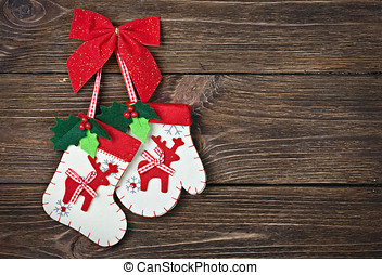 Christmas socks with gifts hanging on the wall