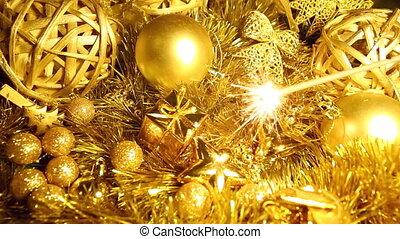 Christmas sparkler and balls in gold - Sparkler on gold blur...