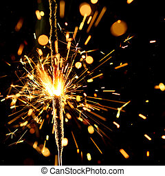 christmas sparkler firework flame on black