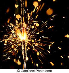 christmas sparkler firework flame on black
