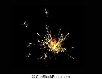 Christmas sparkler on black background. Bengal fire