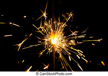 Christmas sparkler on black background. Bengal fire