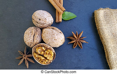 Cinnamon sticks, anise star and walnuts on the table