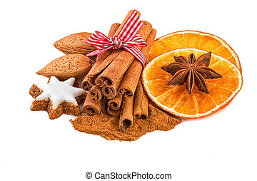 Christmas spice decoration with cinnamon, anise, almond nuts and orange slices.