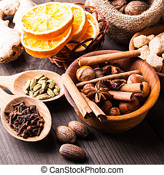 Christmas spices - nuts, brown sugar, dried orange,...