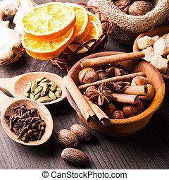 Christmas spices - nuts, brown sugar, dried orange,...