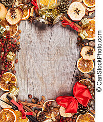 Christmas spices with dry orange and apple slices in frame...