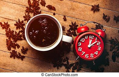 Christmas star anise tea and alarm clock