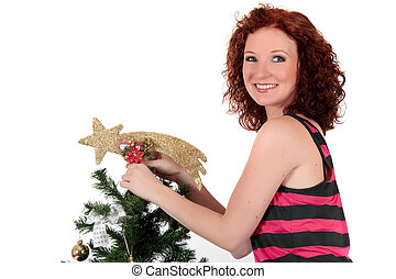 Christmas star. Attractive young woman