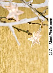 christmas star lights on golden background