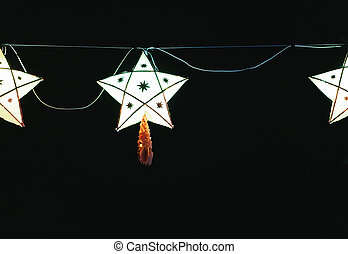 Christmas star shining bright on the street. The decorations of Tha Rae people in Sakon Nakhon, Thailand for the holidays.
