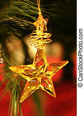 Christmas star - Yellow star ornament dangling from...