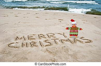 Christmas starfish with greeting on beach
