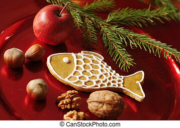 Christmas still life - Gingerbread cookie, nuts and red apple