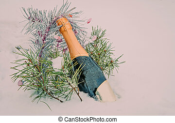 Christmas still life, spruce and a bottle of champagne in...