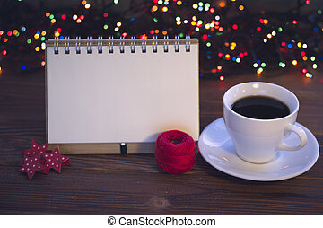 Christmas still life with coffee cup with a saucer and a...