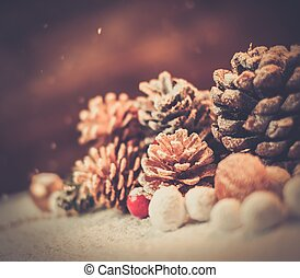 Christmas still life with cones on a snow