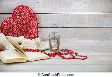 Christmas still life with lantern and red beads on wooden background
