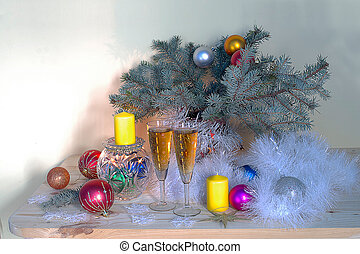 Christmas still life with spruce branches, balloons, champagne, decorations.