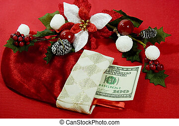 This is a lovely little Christmas stocking with a crisp one hundred dollar bill inside of it. Delicately arched over the stocking is a pretty table decoration in red, white and green.