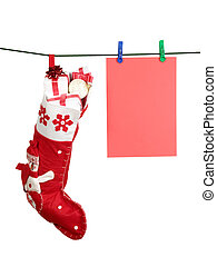 Christmas stocking full of presents and sheet of paper