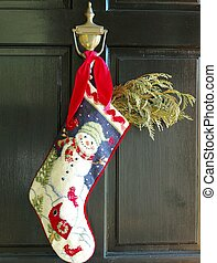 CHRISTMAS STOCKING - A Christmas stocking suspended from a...