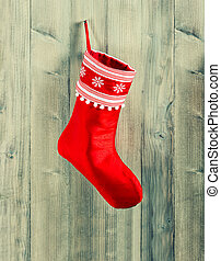 christmas stocking. red sock with white snowflakes hanging