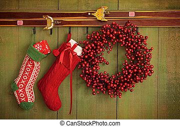 Christmas stockings and wreath hanging on  wall