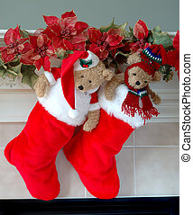 Christmas Stockings on the Mantle - Red and white fur christmas stockings, each with a stuffed bear inside, hang on the mantle above the fireplace on Christmas Eve.