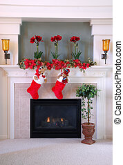 Christmas Stockings on the Mantle - Red and white fur christmas stockings hang on the mantle above the fireplace.