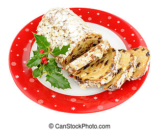 Traditional stollen fruit cake on a festive plate isolated on a white background