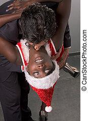 Christmas striper Mrs Santa Claus seducing man