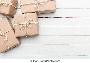 Christmas style rustic brown paper package tied up with...