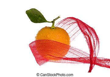 christmas sweet in red bow. orange fruit