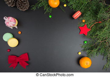 Christmas sweets and decorations on chalkboard. Space for your text