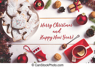 Christmas sweets baking cookies on the plate. Decorated for Christmas cookies, christmas bumps. tea drink. inscription congratulations postcard. Top view