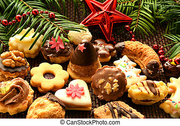 Christmas sweets, cookies, decoration and needles