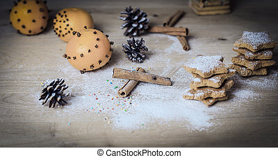 Christmas table. background image of cinnamon sticks, oranges an