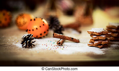 Christmas table. background image of cinnamon sticks, oranges and