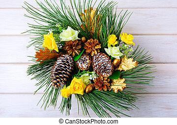 Christmas table centerpiece or door wreath with golden cones
